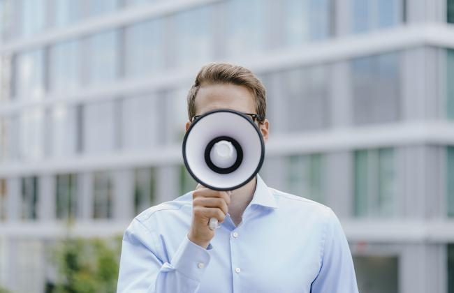 Man with Megaphone (Source: Westend61/Getty Images)